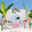 Wedding arch - tent - decorated with flowers on beach, tropical — Stock Photo #55275081