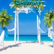 Wedding arch decorated with flowers on tropical sand beach, outd — Stock Photo #55275277