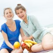 Two young happy women enjoying life during outdoor picnic with f — Stock Photo #55275803