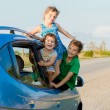 Three happy kids in car, family trip, summer vacation travel — Stock Photo #55276039