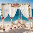 Постер, плакат: Beach wedding set up tropical outdoor wedding reception beauti