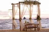 Wedding table decoration inopen air restaurant on beach at sunse — Stock Photo