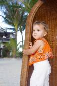 Cute baby child girl on tropical bacground — Stock Photo