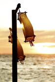 Paper lanterns at sunset sea background — Stockfoto