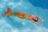 Beautiful mermaid swimming in water — Stock Photo