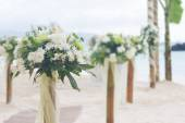 Wedding flower post and decoration on beach — Stock Photo
