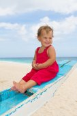 Outdoor portrait of happy baby child on board of sea boat — Stock Photo