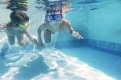 Two children diving underwater in googles — Photo