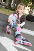 Cheerful roller skater - child girl - in protective equipment si — Stockfoto