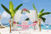 Wedding arch - tent - decorated with flowers on beach, tropical  — Stock Photo