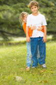 Happy boy and girl, brother and sister, outdoor portrait on natu — Stock Photo