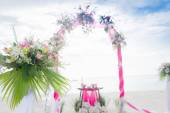 Wedding arch decorated with flowers on tropical sand beach, outd — Stock Photo