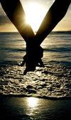 Hands together at sunset — Foto de Stock