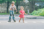 Young happy boy faving fun on roller scates on natural backgroun — Stockfoto