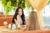 Young beautiful woman in street cafe — Stok fotoğraf