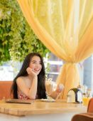 Young beautiful woman in street cafe — Stock Photo