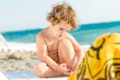 Cute baby child on sea beack background — Stock Photo