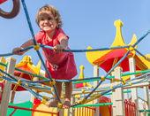 Cute happy child girl on playground — Stock Photo