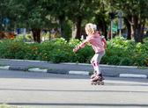 Happy child girl roller skating — Fotografia Stock