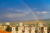Rainbow over roofs of old medieval town — ストック写真