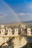 Rainbow over roofs of old medieval town — Stockfoto