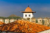 Sunset view of old medieval town roofs — Stockfoto