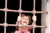 Chid girl in prison, cage — Stockfoto