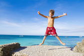 Young happy child boy on tropical beach — Stock Photo