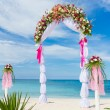 Wedding arch, cabana, gazebo on tropical beach decorated with fl — Stock Photo #57501291