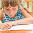 Young child girl writing in notebook, outdoors portrait, educati — Stock Photo #57501511
