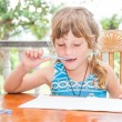Young child girl writing in notebook, outdoors portrait, educati — Stock Photo #57501515
