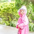 Young child girl in raincoat under rain drops, outdoor portrait — Stock Photo #57501555