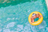Swimming, summer vacation - lovely child boy playing in blue wat — Stock Photo