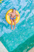 Swimming, summer vacation - lovely child boy playing in blue wat — Zdjęcie stockowe