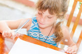Young child girl writing in notebook, outdoors portrait, educati — ストック写真