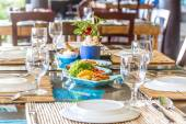 Table setup in outdoor cafe, small restaurant in a hotel, summer — Stockfoto
