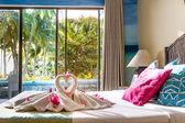 Towel decoration in hotel room, towel birds, swans, room interio — Stock Photo