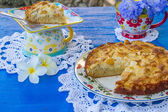 Freshly baked apple pie in natural background — Stock Photo