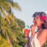 Young beautiful woman drinking cocktails, enjoying summer vacati — Stock Photo #70459793