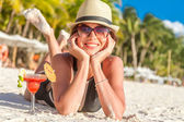 Young happy beautiful woman enjoying summer vacation on tropical — Stock Photo