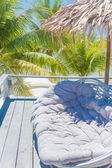 Lounge area on tropical beach background — Stock Photo