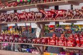 Wooden crafted figurines in a souvenir shop, cambodia, siem reap — Stok fotoğraf