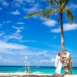 Young loving couple on beach background, wedding day, outdoor be — Stock Photo #70462919