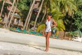 Young healthy girl, woman, in sport clothes walking by tropical  — ストック写真