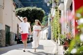 Young couple running and looking each other, Positano, Italy — Stock Photo