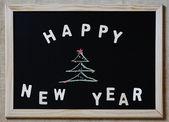 Happy new year christmas tree on blackboard — Foto de Stock