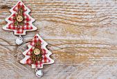 Christmas trees on wooden background — Stock Photo