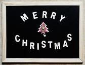 Merry christmas tree on blackboard — Stockfoto