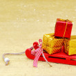Christmas sleigh and gift box decoration on golden background — Foto Stock #58536013