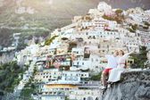 Young bride and groom relaxing and smiling after wedding in Positano, Italy — Stock Photo